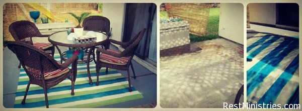 """OUTDOOR PATIO """"RUG"""" is made from patio paint (grey) and Patio Paint (via Michael's) and a whole lot of bending over to pain this stained patio. #diy"""